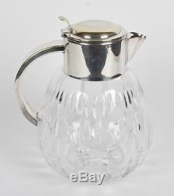VINTAGE OCCUPIED GERMAN CUT CRYSTAL AND SILVERPLATE PITCHER With GLASS ICE INSERT